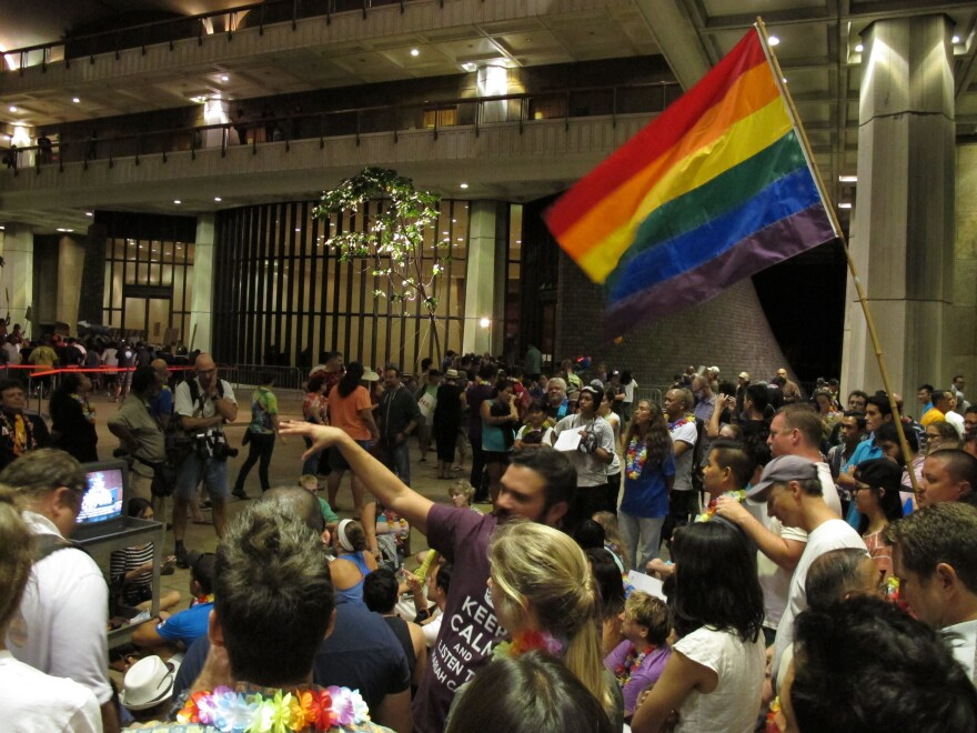Proponents of gay marriage rally outside House chambers at the Hawaii Capitol in Honolulu on Friday.