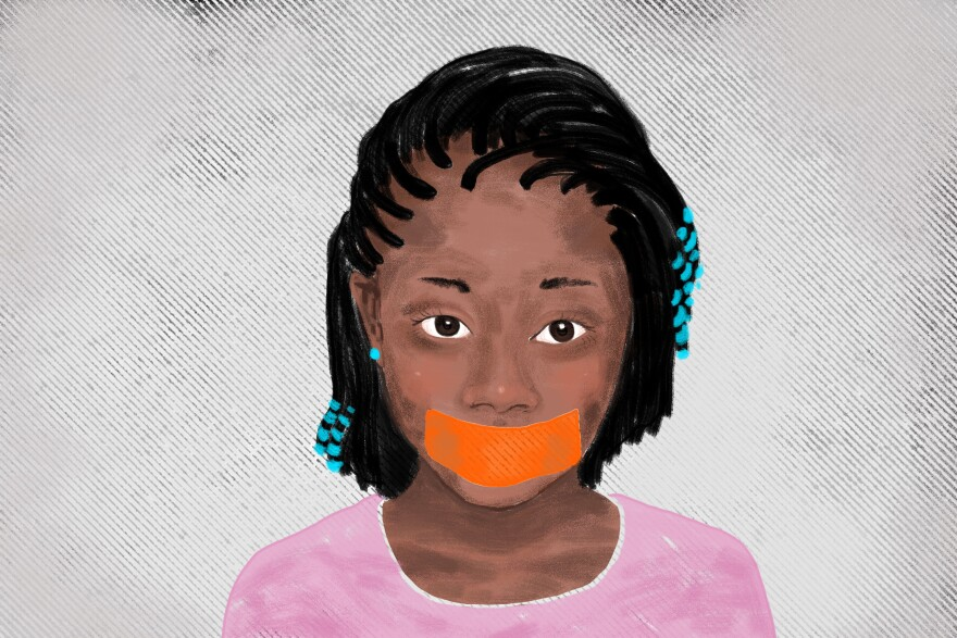 Young black girl with mouth taped shut