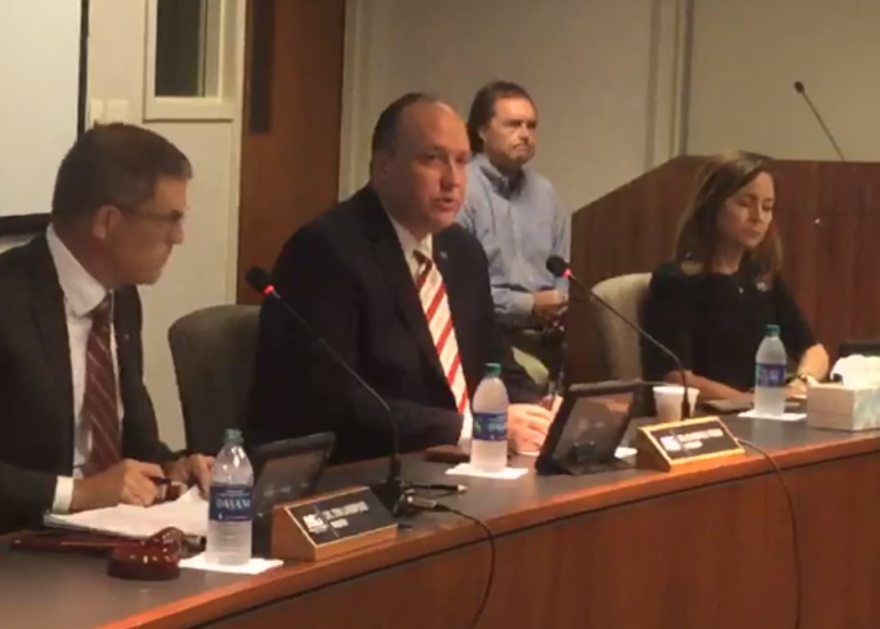 ASU System President Dr. Charles Welch (center) speaking at the Board of Trustees meeting with Chairman Dr. Tim Langford (left) and Trustee Christy Clark (right).