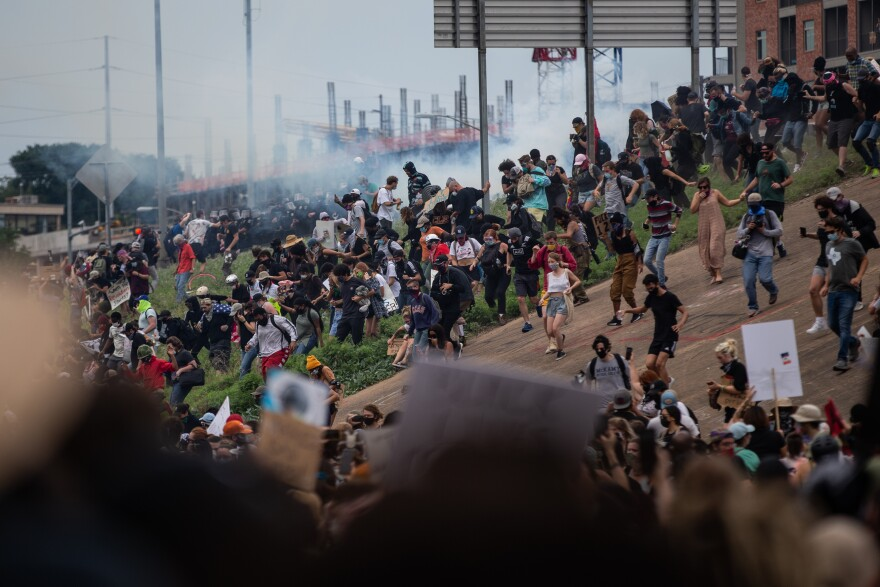 Law enforcement use tear gas and smoke to get protesters off I-35.