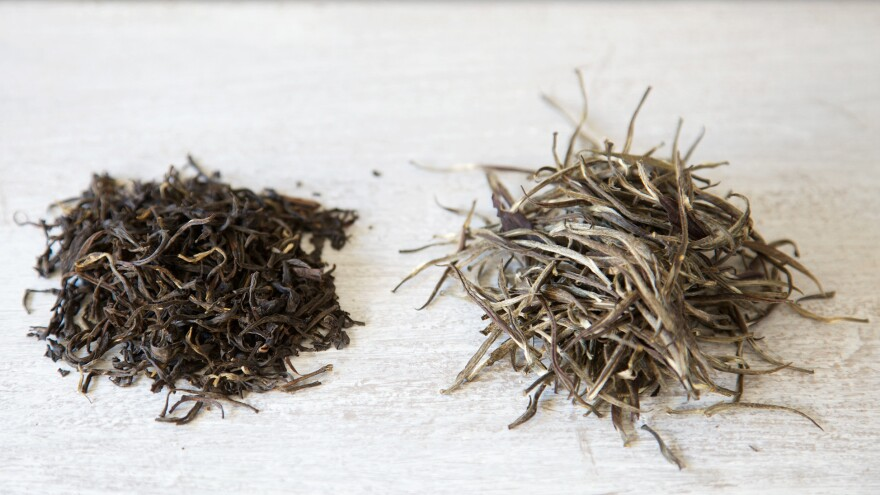 Kenya hand-rolled purple varietal oolong (left) and silver needle purple varietal white tea leaves (right) from the online retailer What-Cha.