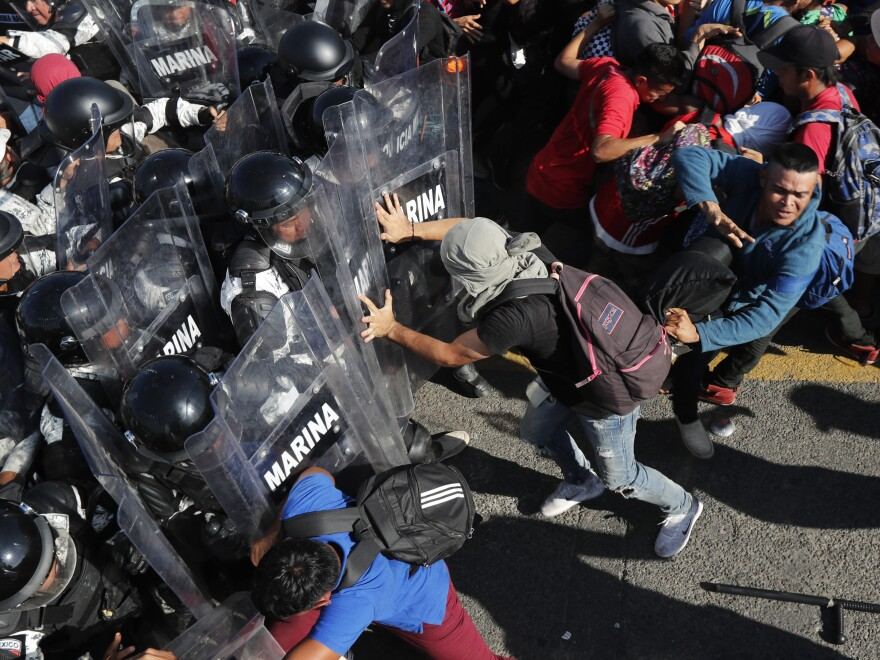 Migrants charge on Mexican National Guard troops at the border crossing between Guatemala and Mexico, near Ciudad Hidalgo, Mexico and Tecun Uman, Guatemala, on Jan. 18.