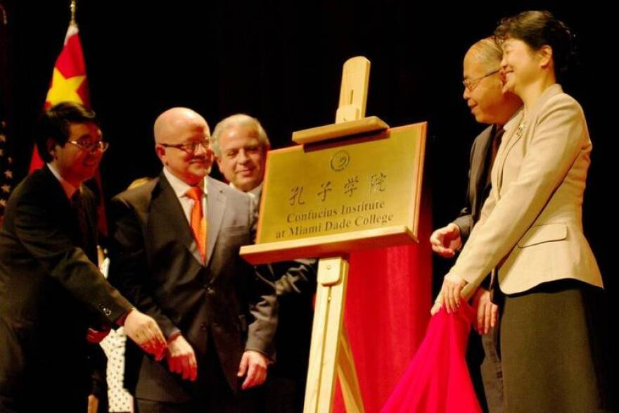 From left, Yongli Wang, Eduardo Padron, professor Fangming Xu and Mme Yanping Gao, Chinese consul general, unveil the new Confucius Institute Plaque at the inauguration ceremony in 2010.