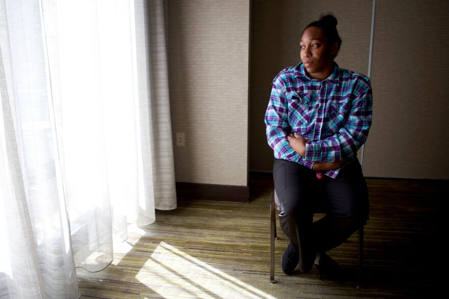 """Daisha Smith says she only realized she had been sued over her hospital bill when she saw her paycheck was being garnished. """"I literally have no food in my house because they're garnishing my check,"""" she says."""
