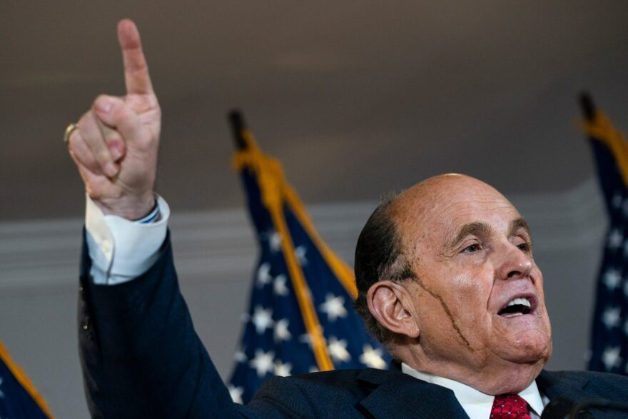 Rudy Giuliani speaks to the press about various lawsuits related to the 2020 election, inside the Republican National Committee headquarters in Washington, DC.