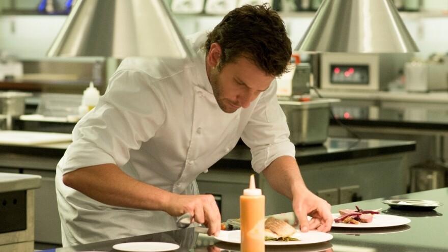 Bradley Cooper as Chef Adam Jones in a scene from <em>Burnt</em>.