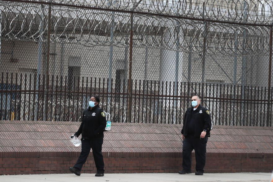People wearing protective masks leave the Cook County jail complex on April 09, 2020 in Chicago, Illinois. (Scott Olson/Getty Images)