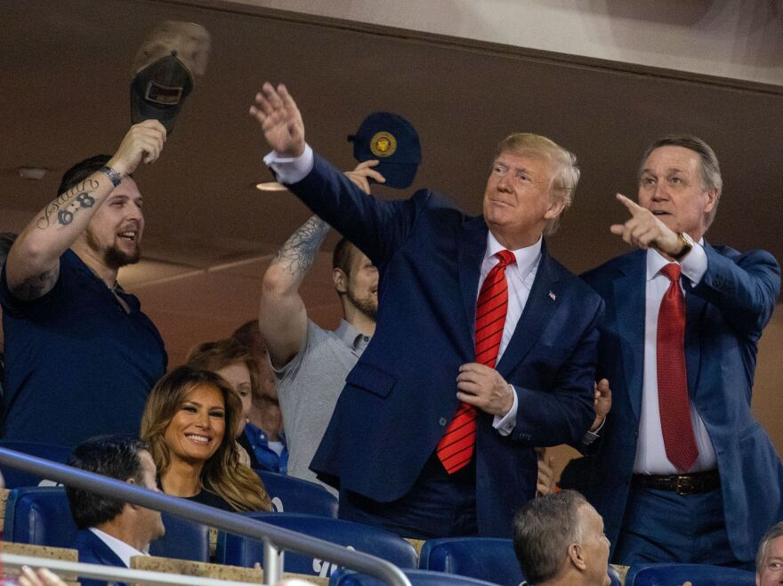 President Trump stands during Game 5 of the World Series at Nationals Park in Washington, D.C., last October.