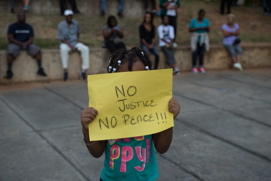 Many of the protests on Wednesday, like the demonstration attended by this little girl, were peaceful. Charlotte has a reputation as a tolerant, diverse and progressive city, but a police killing last year had shaken that perception even before the events of Tuesday and Wednesday.
