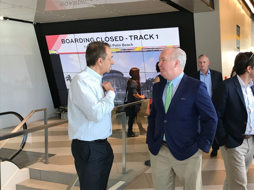 Tampa mayor Bob Buckhorn (right) briefly met with Fort Lauderdale mayor Dean Trantalis on Thursday to learn more about Brightline.