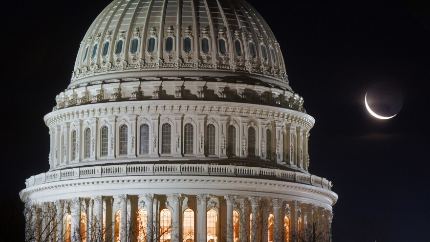 A sliver of moon rises behind the Capitol dome in Washington, D.C. While Congress has shown signs of life this spring, its veritable hibernation has left plenty of room for states to experiment with policy.