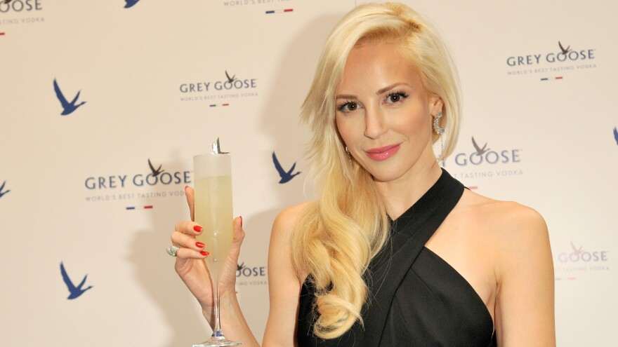 With her Instagram response, Louise Linton, shown at a 2014 Grey Goose promotional event in Scotland, has opened the door for a discussion on a progressive tax system.