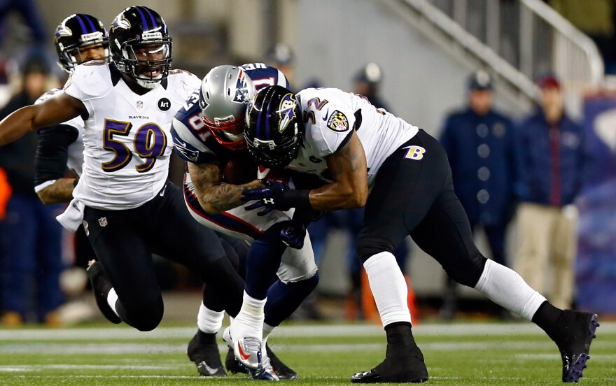 Baltimore Ravens Ray Lewis tackles New England Patriots Aaron Hernandez with his helmet during the 2013 AFC Championship game this year.