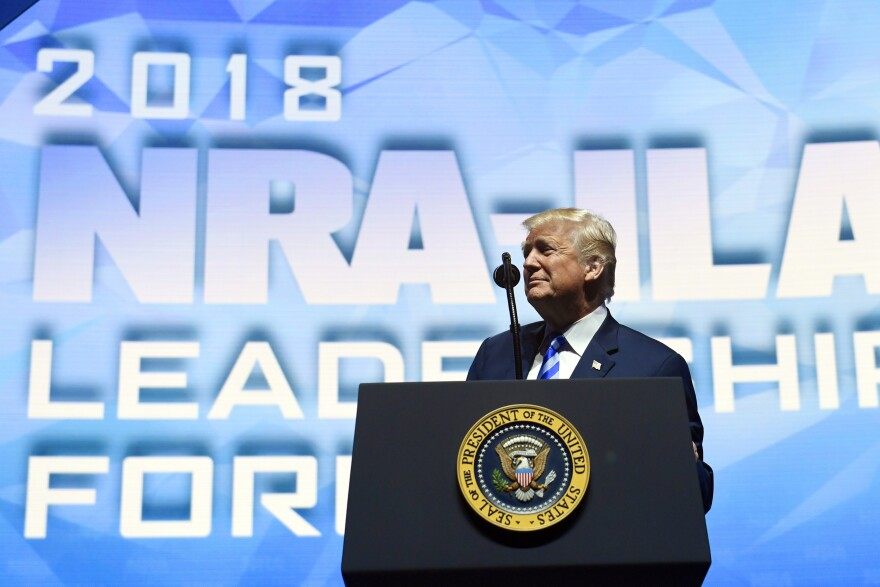 President Trump speaks to a cheering audience at the National Rifle Association's annual convention in Dallas on Friday.