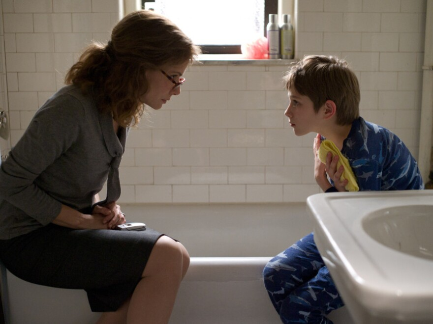 Oskar lies to his mother, played by Sandra Bullock, about a series of phone messages left by his father on the morning of Sept. 11, 2011.