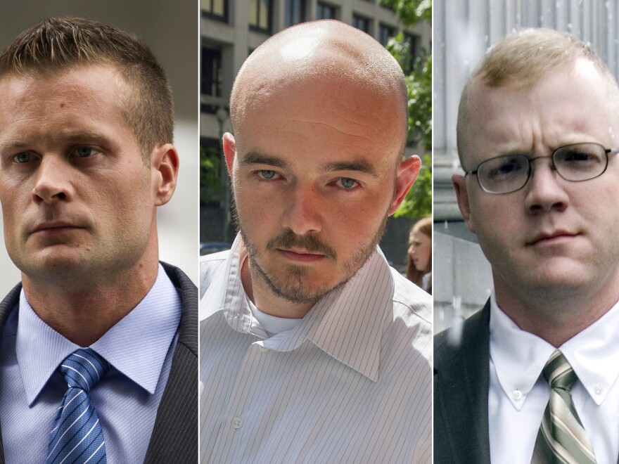 This combination made from file photos shows Blackwater guards, from left, Dustin Heard, Evan Liberty, Nicholas Slatten and Paul Slough. On Tuesday, Dec. 22, 2020, President Donald Trump pardoned 15 people, including Heard, Liberty, Slatten and Slough, the four former government contractors convicted in a 2007 massacre in Baghdad that left more a dozen Iraqi civilians dead.
