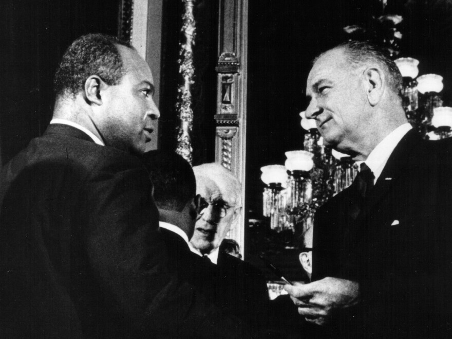 Aug. 6, 1965: President Lyndon B. Johnson presents one of the pens used to sign the Voting Rights Act of 1965 to James Farmer, Director of the Congress of Racial Equality.