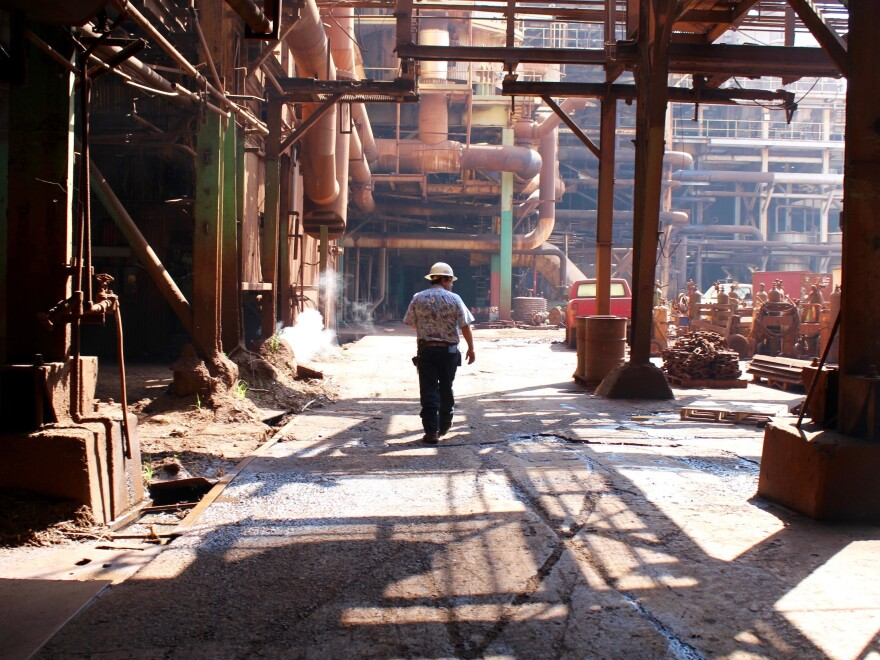 Robert Luuwai, the vice president of HC&S, walks through the sugar mill on Maui for one of the last times.