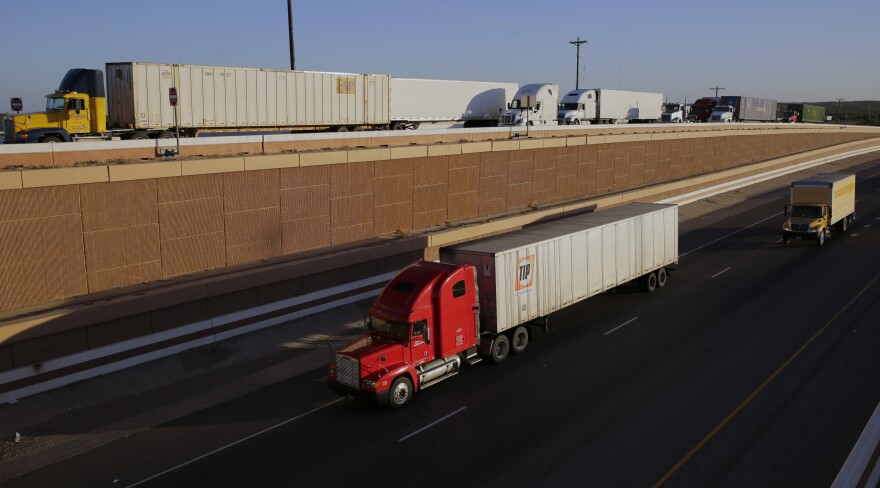 Trucks move along Interstate 35 in Laredo, Texas. It's a major thoroughfare for trade between Mexico and the U.S.
