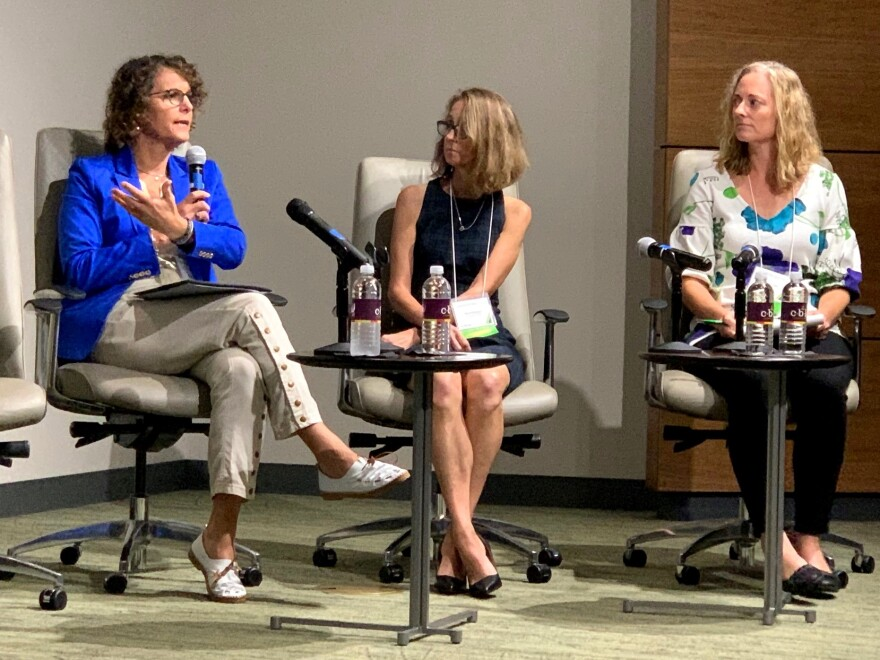 USF professor Dr. Marissa Levine (l) talked about the importance of acknowledging how a history of social injustices contributed to certain populations being more vulnerable to climate change today.