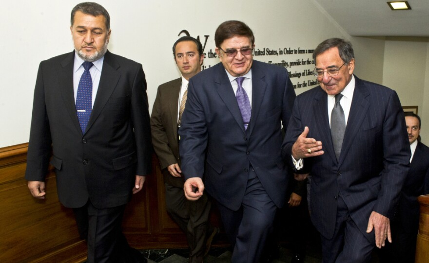 Secretary of Defense Leon E. Panetta, far right, escorts Afghanistan's Minister of National Defense Abdul Rahim Wardak (center) and Minister of Interior Gen. Bismillah Khan Mohammadi (left) in the Pentagon.