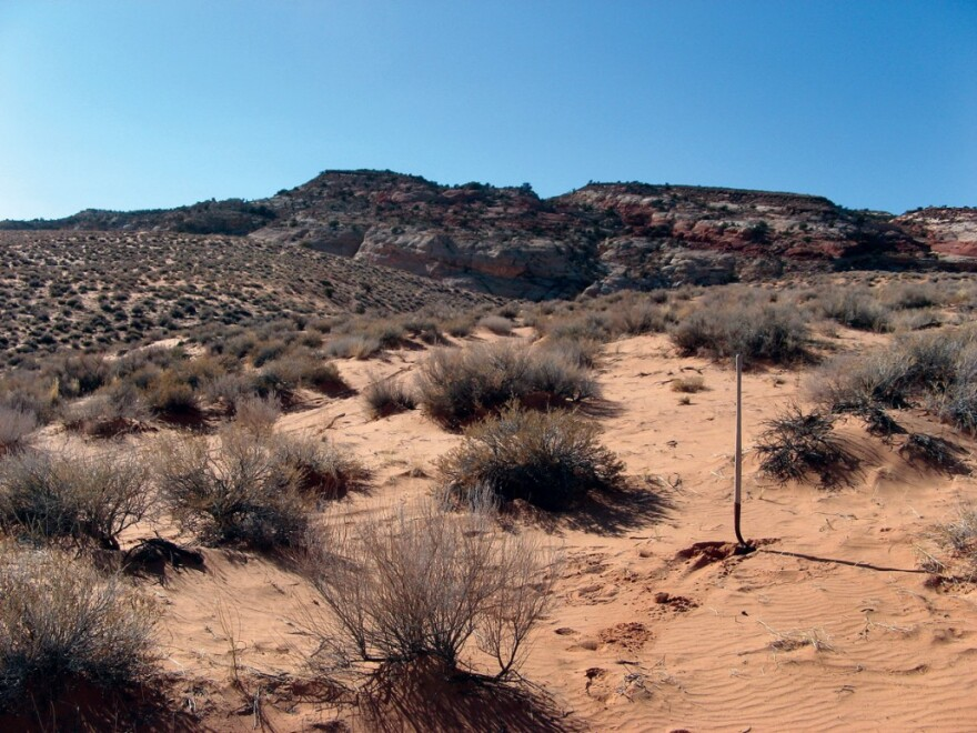 Photo of a landscape of red sands and red rock in Kane County.