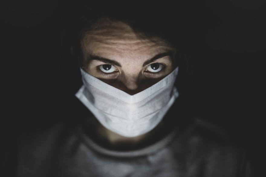 man.in_.face_.mask_by.Engin_.Akyurt_Unsplash.stock_.photo_.jpg