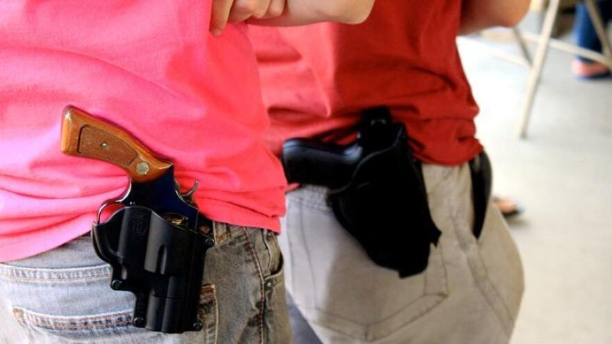 stock photo of guns in holsters