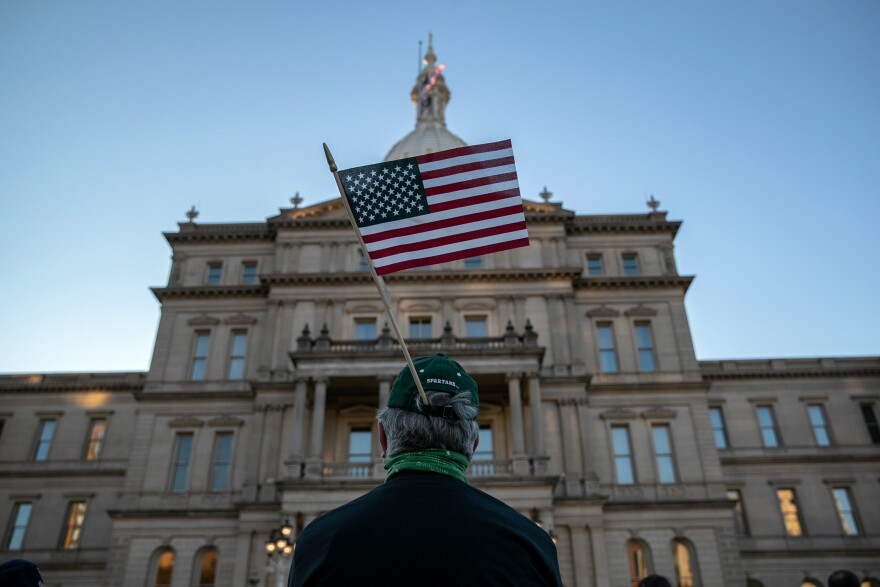 "Protesters attend a ""Count On Us"" rally at the Michigan State Capitol building on November 04 in Lansing, Mich."
