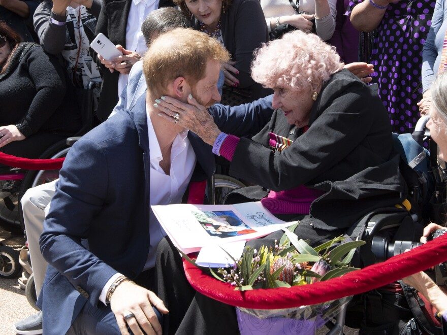 Prince Harry, Duke of Sussex greets his fan and friend Daphne Dunne in Sydney in 2018.