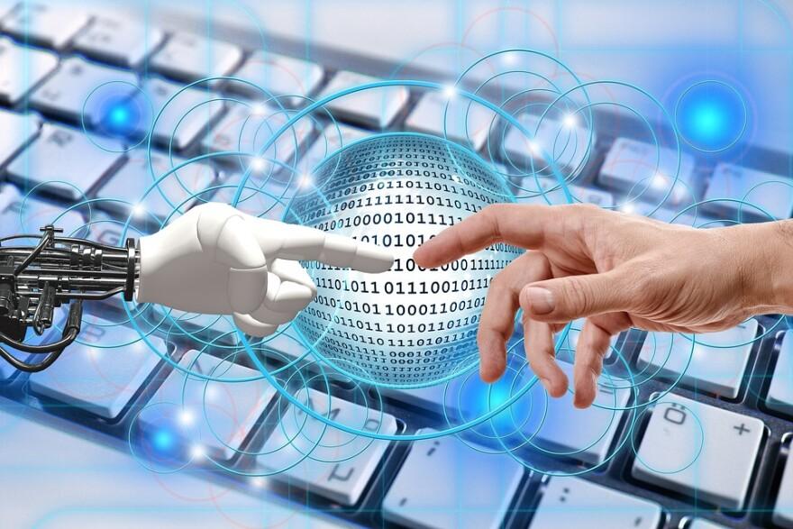 Human and Robot Hands meet.jpg
