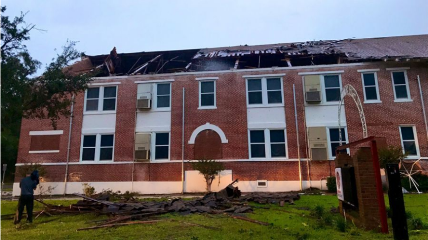 A tornado from Tropical Storm Nestor blew off a portion of the roof at Kathleen Middle School in Lakeland.
