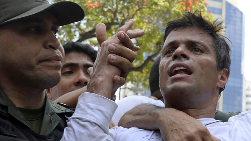 Leopoldo Lopez, a political opponent Maduro, is taken into custody by the National Guard during a demonstration in Caracas on Tuesday.