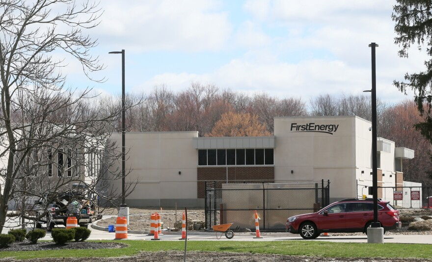 A vehicle drives past the new FirstEnergy facility on the company's West Akron Campus off Mull Avenue on Wednesday, April 10, 2019 in Akron, Ohio.