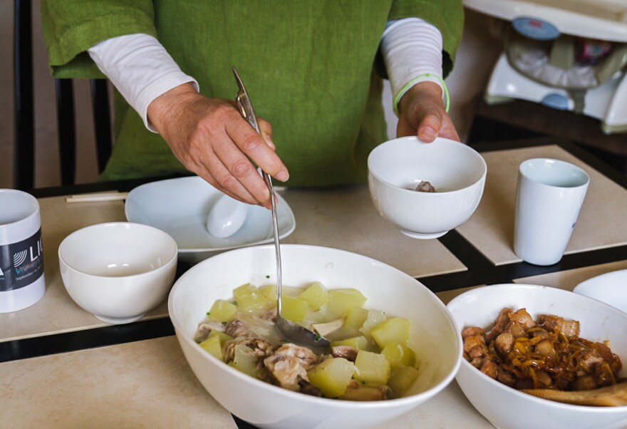 Dr. Marilyn Wong serves green papaya and pigs' feet soup, a Vietnamese dish believed to fortify new mothers.