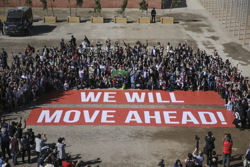 Participants at the Marrakech climate conference stage a public show of support for climate negotiations and the Paris agreement on Friday.