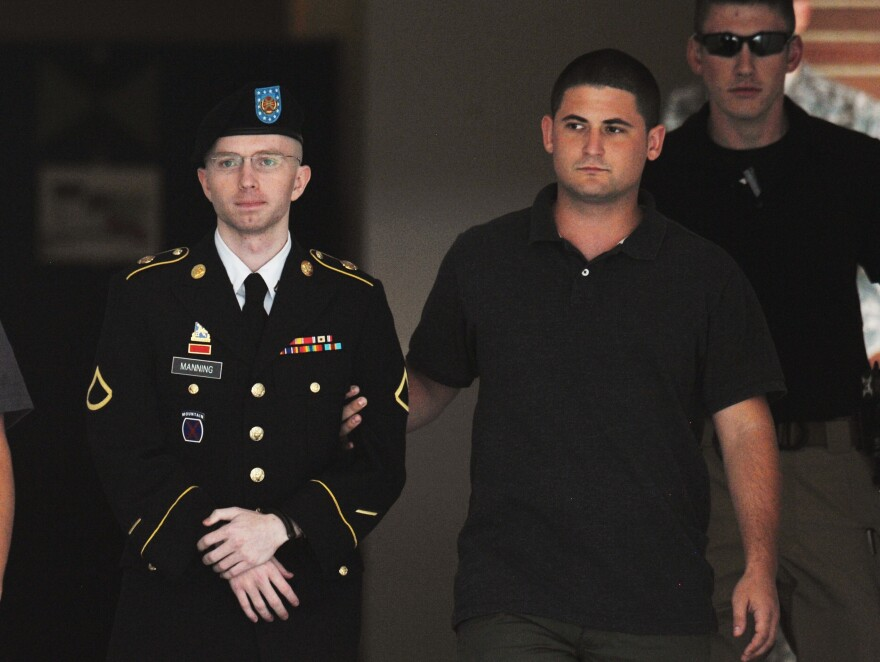 Army Pfc. Bradley Manning is escorted from court on July 25, in Fort Meade, Md.
