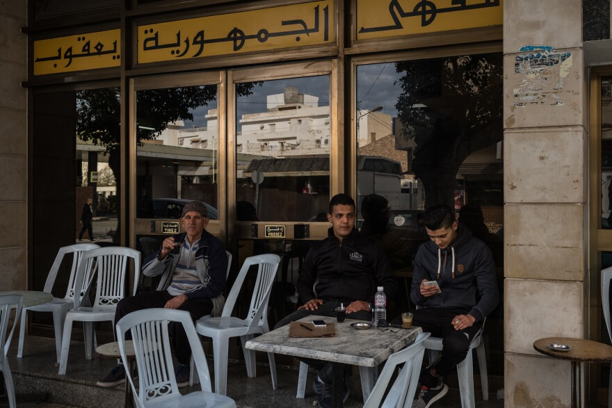 Ahmed Ferjeni (center), 25, sits at a cafe with a friend in Sousse, after going to the employment agency to try and apply for a job. Ahmed trained as a mechanical engineer but has had trouble finding a job in his field.