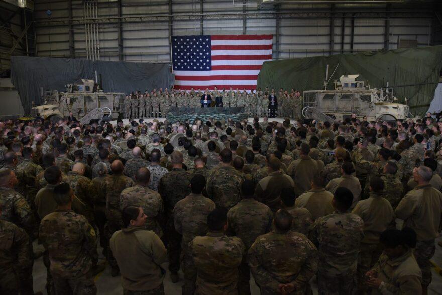 Afghan's President Ashraf Ghani and US President Donald Trump speak to US troops during a surprise visit at Bagram Air Field in Afghanistan.
