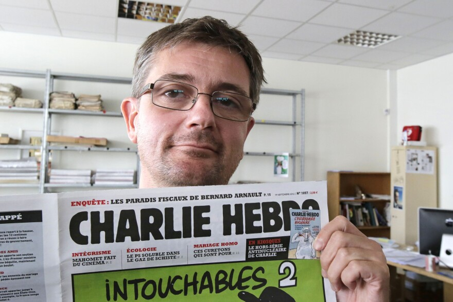 "Stephane ""Charb"" Charbonnier, editor of <em>Charlie Hebdo</em>, is seen on Sept.19, 2012. The late editor takes on politicians, the media and ""Islamophobia"" in a posthumously published book completed two days before he was killed Jan. 7."