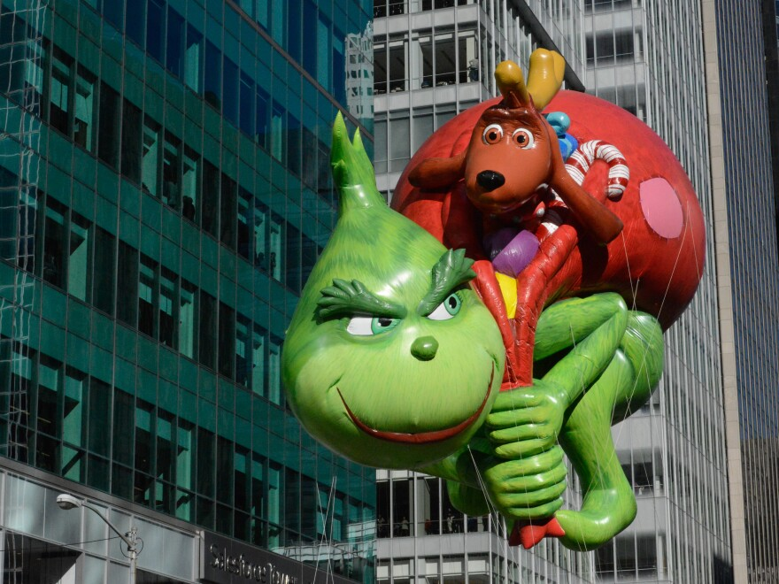 The Grinch balloon floats above New York City during the 2017 Macy's Thanksgiving Day parade. This week, real-life Grinches have been trying to steal Christmas cheer.