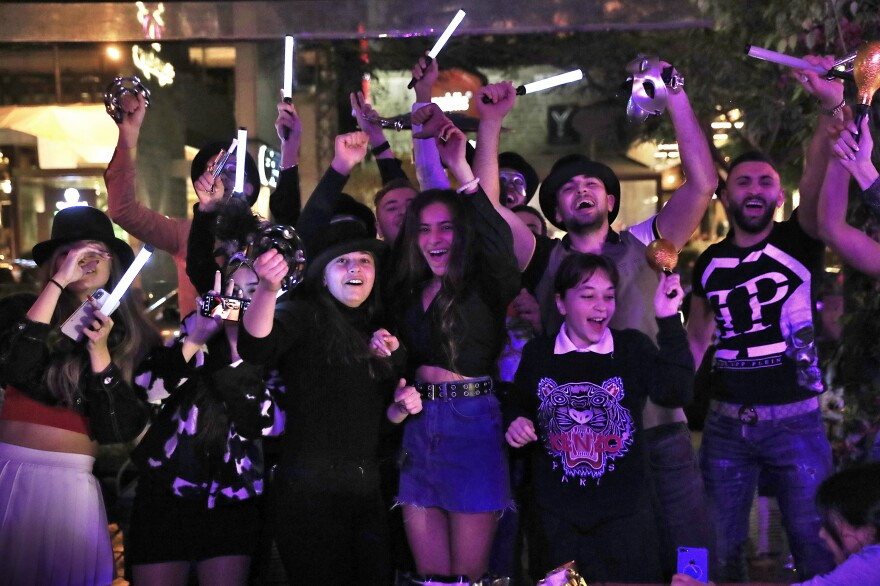 Lebanese people celebrate the New Year in Beirut. Lebanon entered 2021 with record daily new coronavirus cases, and health workers fear that the celebrations could have spread the virus further.