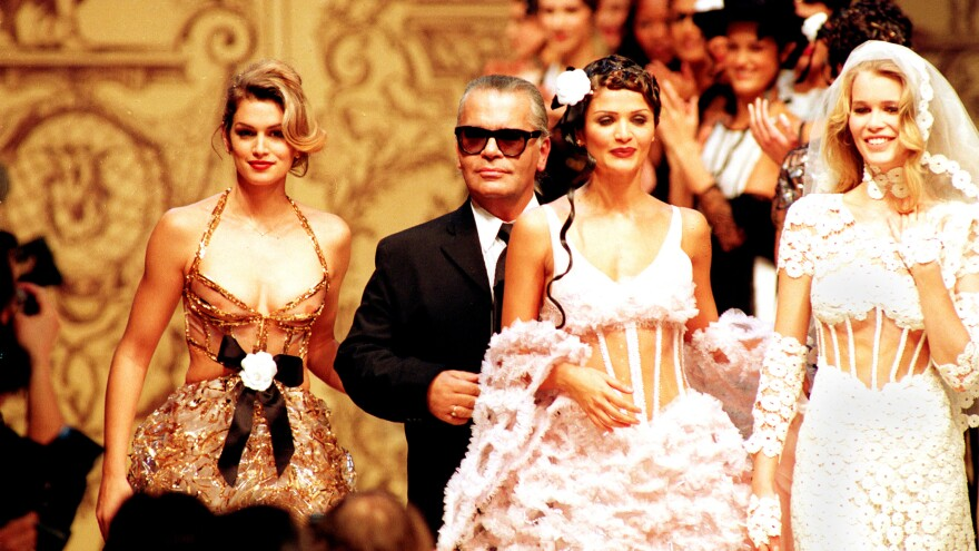 Lagerfeld with models Cindy Crawford, Helena Christensen and Claudia Schiffer at a Chanel show in 1993.
