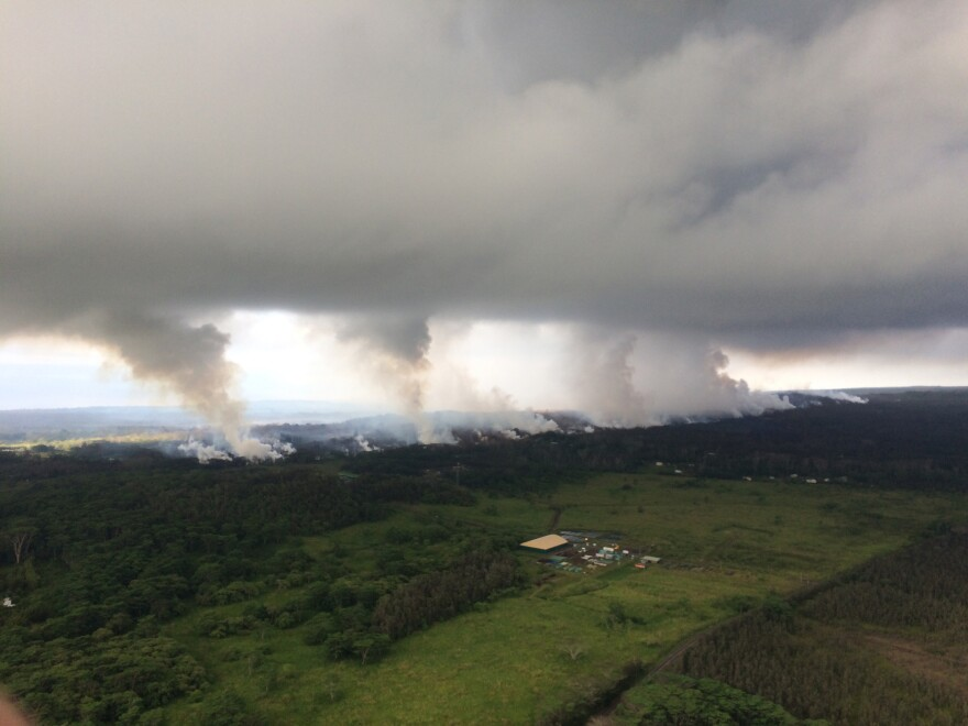 An image provided by the U.S. Geological Survey shows sulfur dioxide plumes rising from Kilauea's fissures along the rift and accumulating in the cloud deck, viewed from a Hawaiian Volcano Observatory overflight on Wednesday.