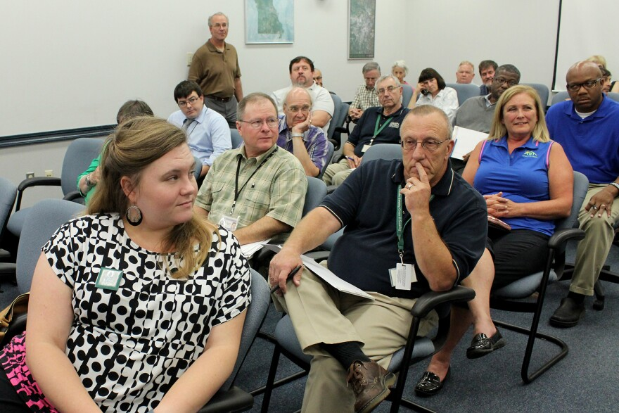 The Sierra Club's Gretchen Waddell Barwick looks on as supporters of her group speak in support of having St. Louis County adopt 2015 international energy efficiency standards for new home construction.