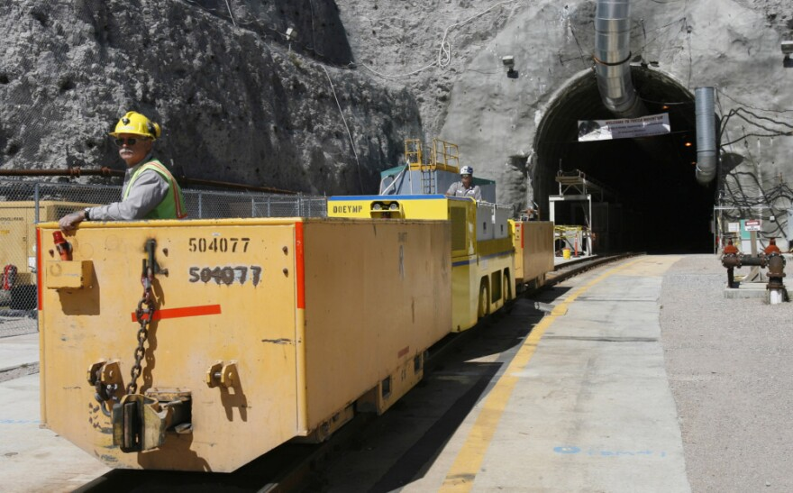 An underground train emerges from the entrance to the planned Yucca Mountain Nuclear Waste Repository in 2006. The government has since abandoned the site as a location for the long-term storage of nuclear waste.
