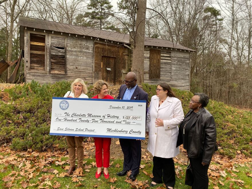 Mecklenburgy County Manager Dena Diorio, Comissioner Susan Harden, and Chairman of the County Commission George Dunlap present a check to Charlotte Museum of History CEO Adria Focht and Trustee Fannie Flono