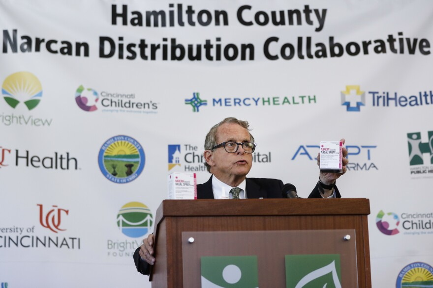 Ohio Attorney General Mike DeWine handles a box of Narcan during a news conference on Thursday, Sept. 7, 2017, in Cincinnati.