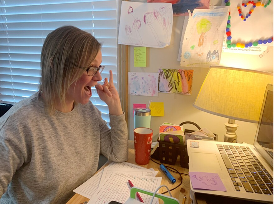 Julie Pierce, a second grade teacher in the Hickman Mills School Districts gestures to her students during a Zoom call. Pierce has spent the entire school year teaching remotely.