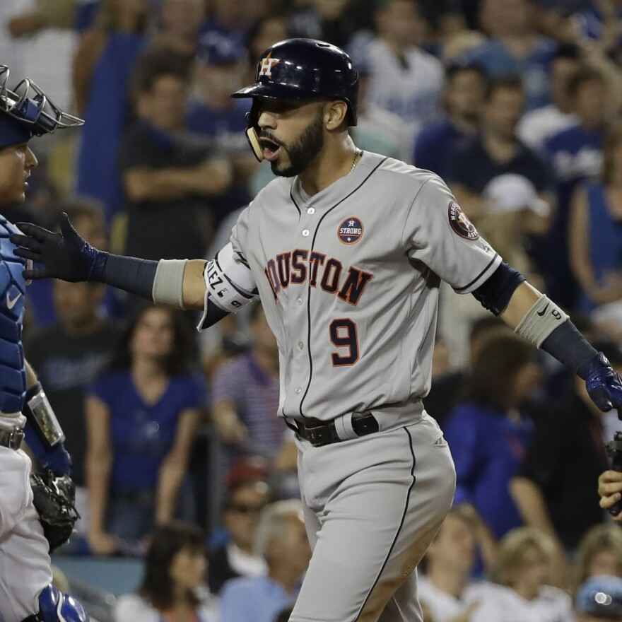 The Houston Astros' Marwin Gonzalez celebrates his ninth-inning home run that tied the score at 3-3 in Game 2 of the World Series with the Los Angeles Dodgers on Wednesday.